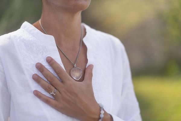 woman with hand on heart showing gratitude