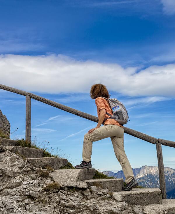 woman hiking mountain stairs